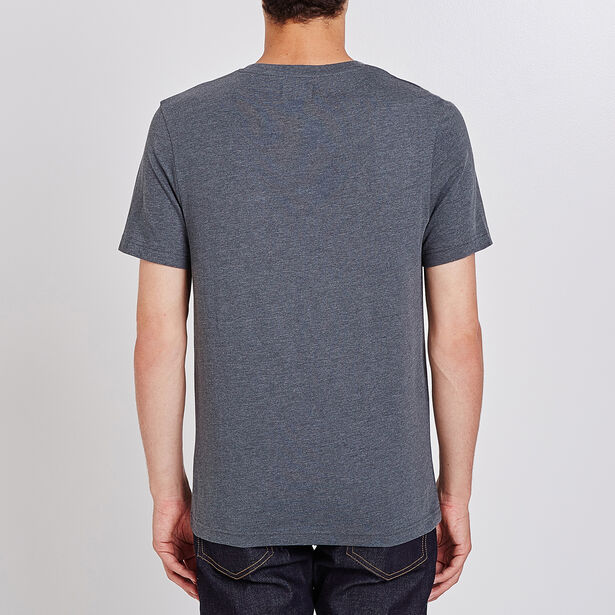 Tee shirt uni col rond à poche rayée verticalement