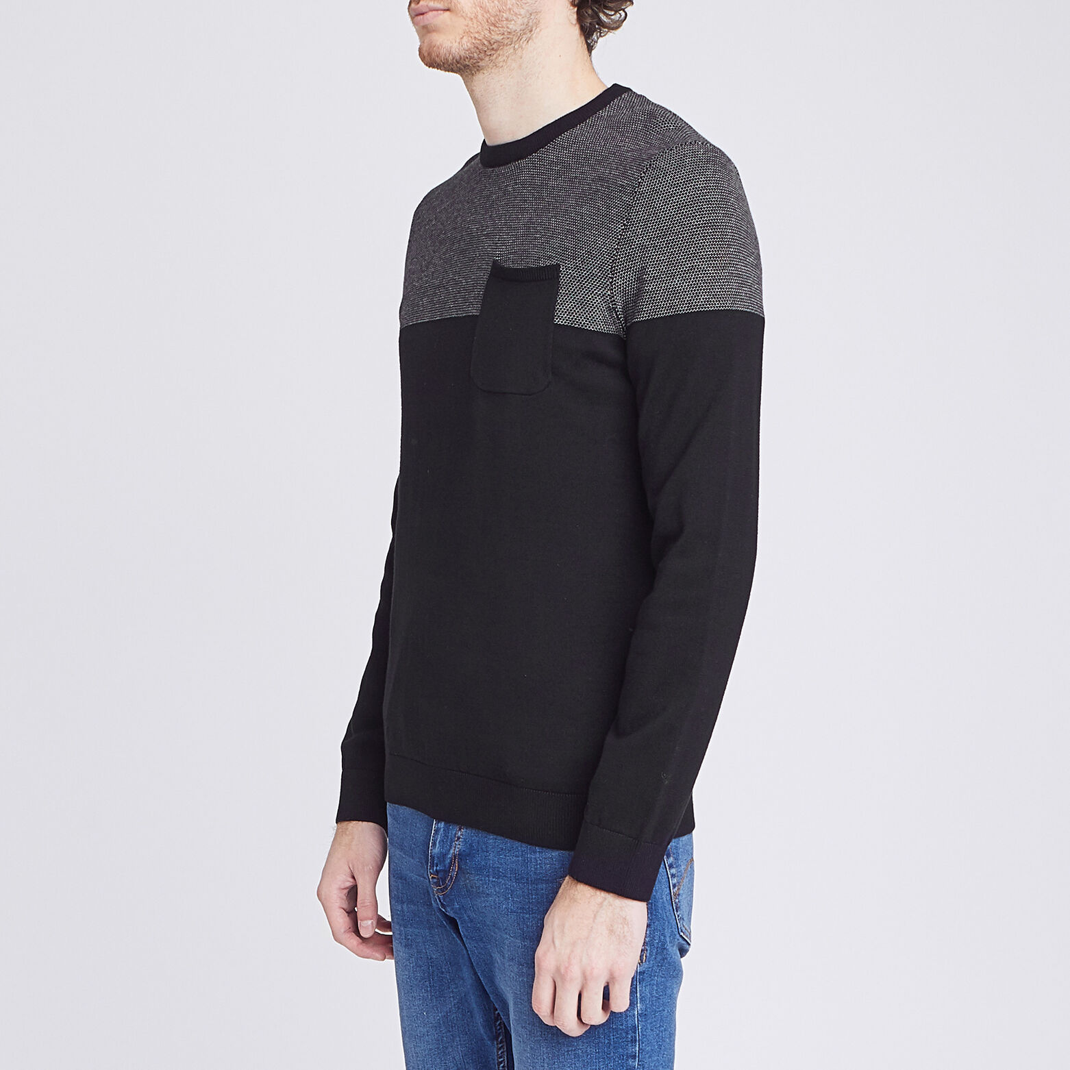 Pull color block bicolore jeu de points