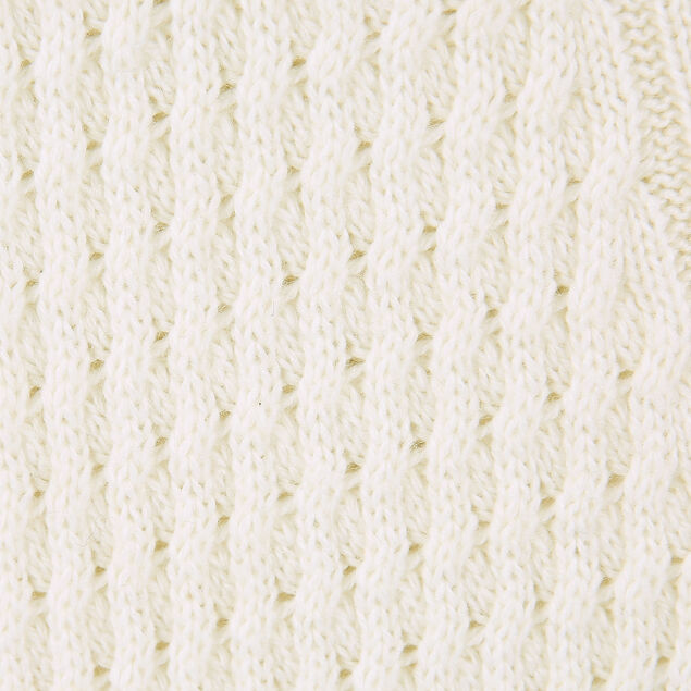 Pull col rond laineux à torsades