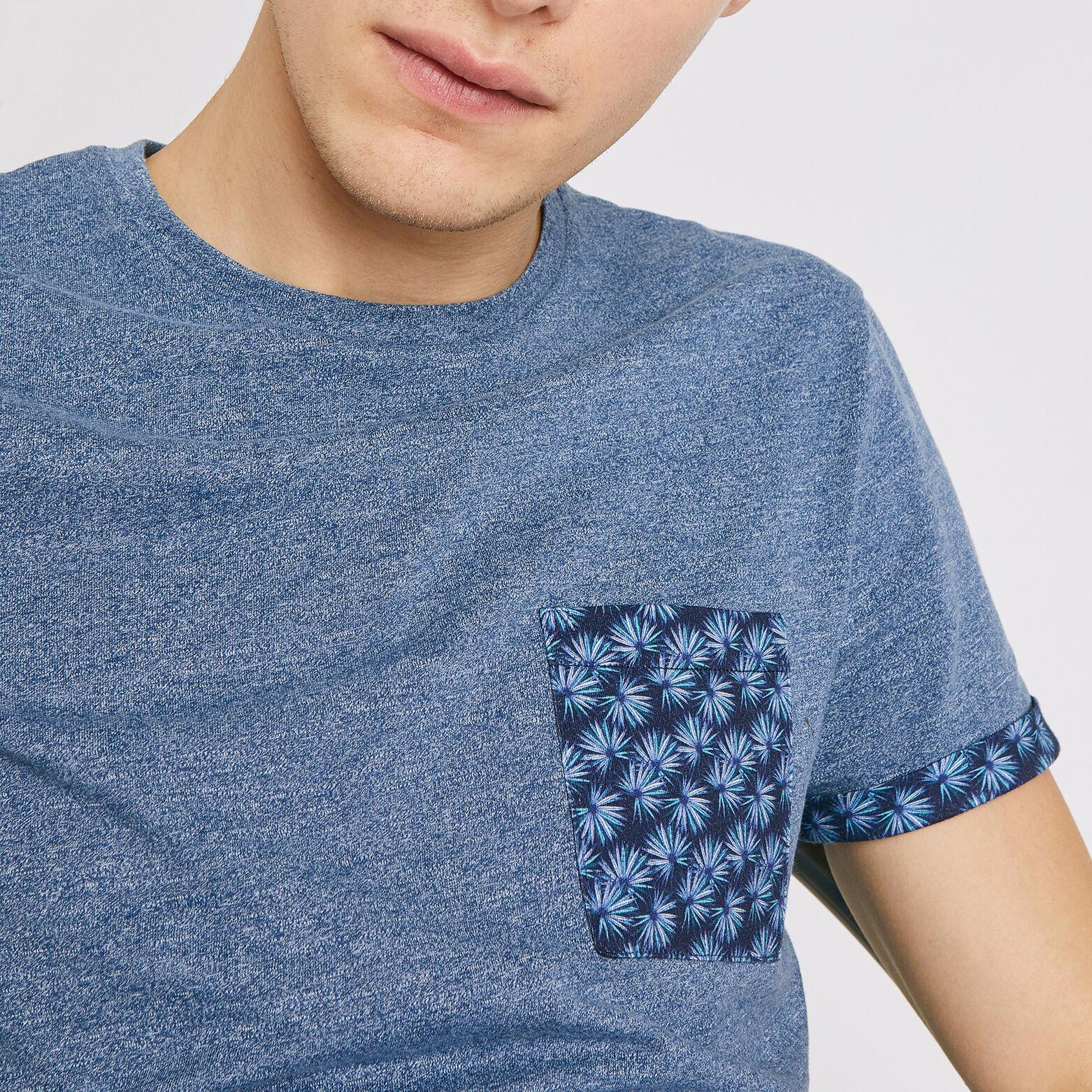 Tee shirt col rond à poche feuillages