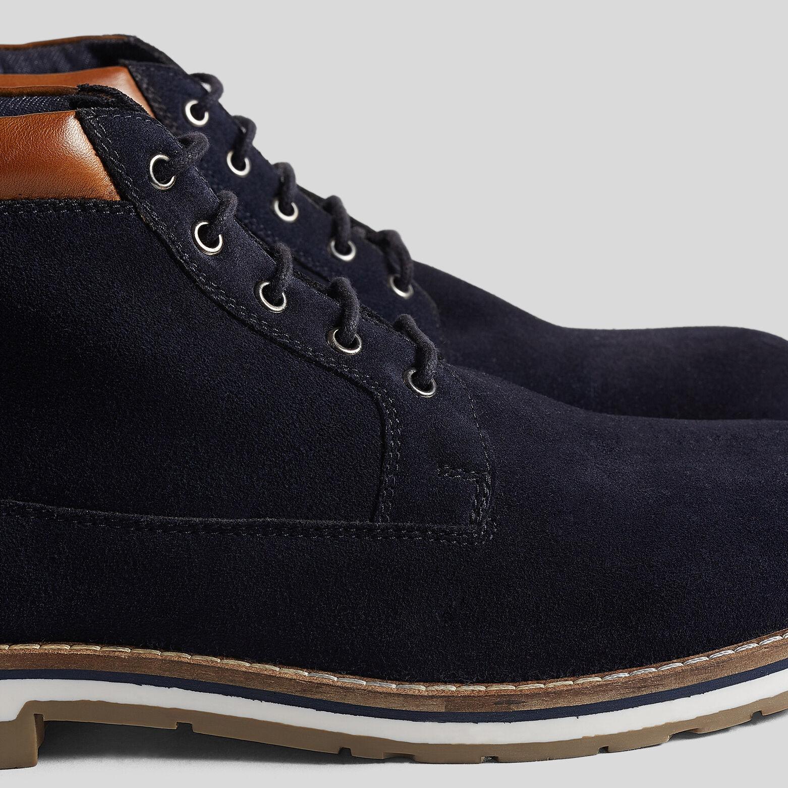 Boots à lacets en daimavec empiècements