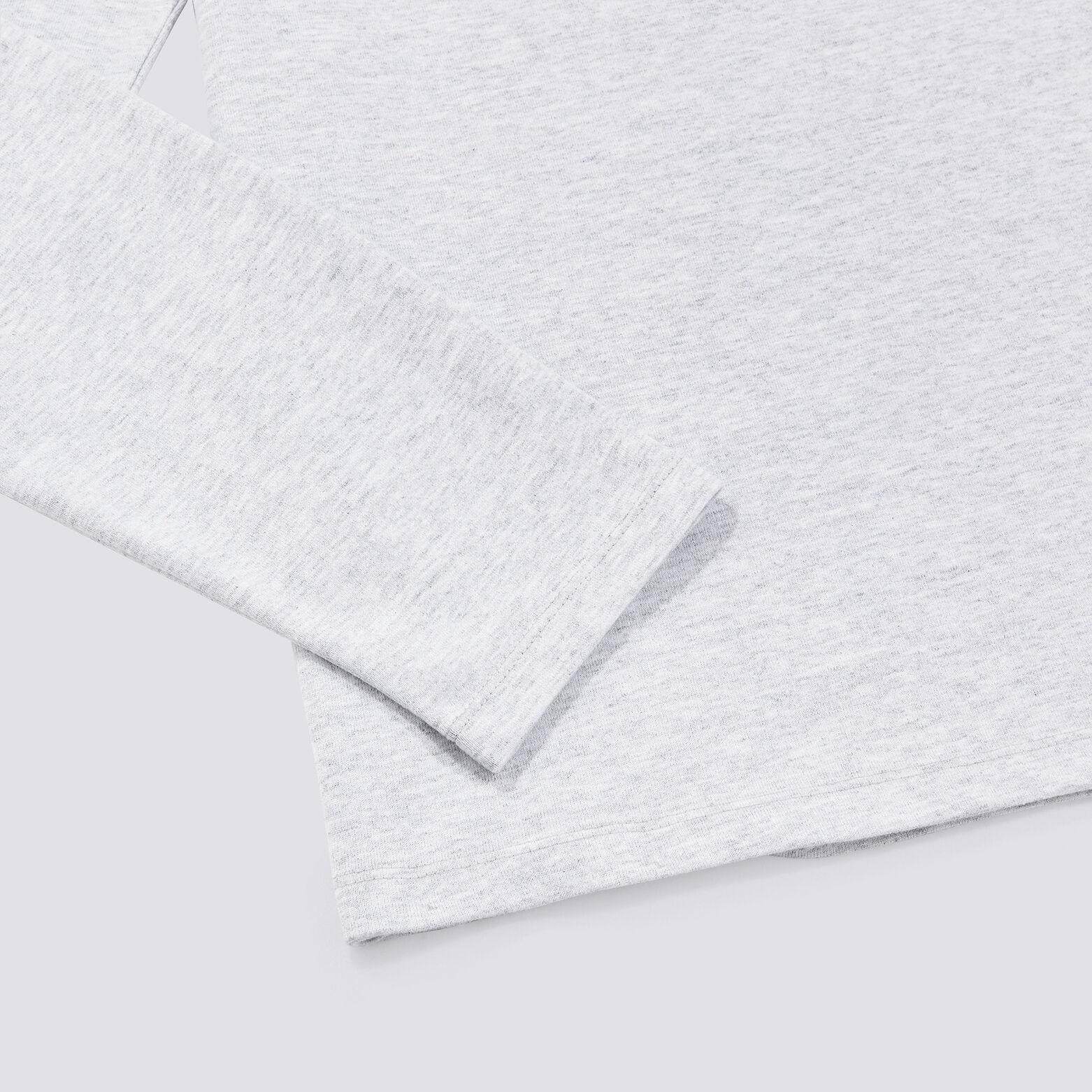 Tee shirt à poche carreaux